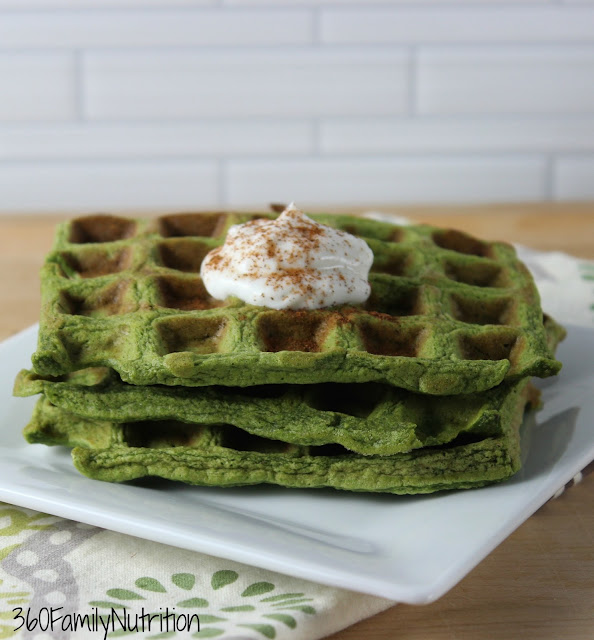 A green waffle made with a banana and spinach