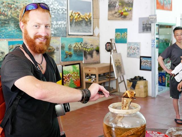 holding snake viper rum mekong delta vietnam