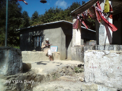 A man immersed in  reading a holy book at Kemundakhal, enroute to Badrinath