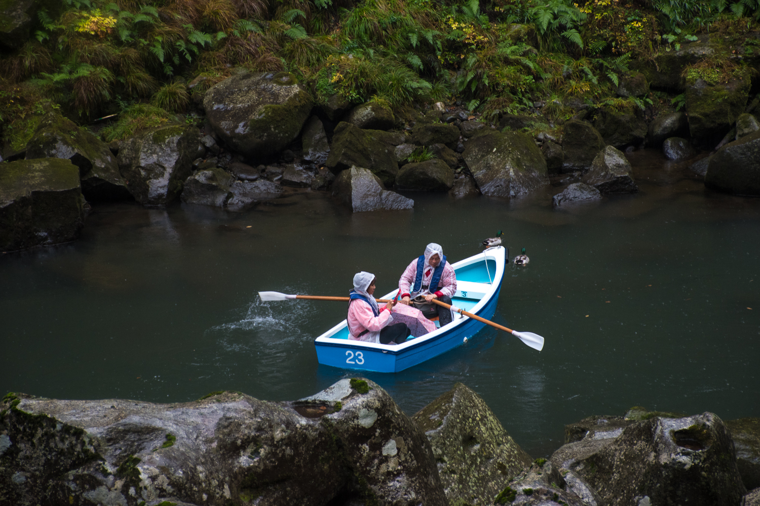 boat rowing in the rain takachiho gorge japan