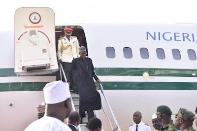 buhari returns today stepping down from an airplane