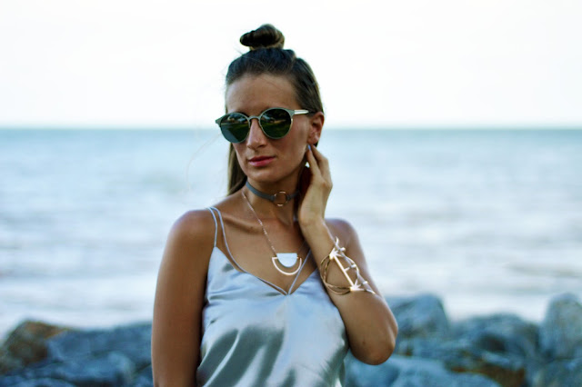 silver silk cami with rose gold jewellery and reflective sunglasses