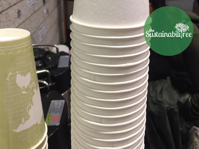 A stack of disposable coffee cups at uOttawa
