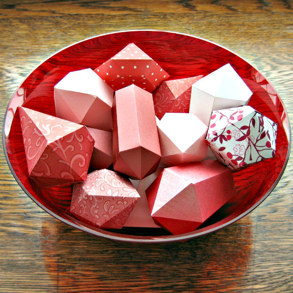 folded red paper gems displayed in glass bowl