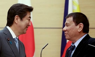 Abe praises Duterte in their reunion, calls Manila visit a 'tremendous honor'