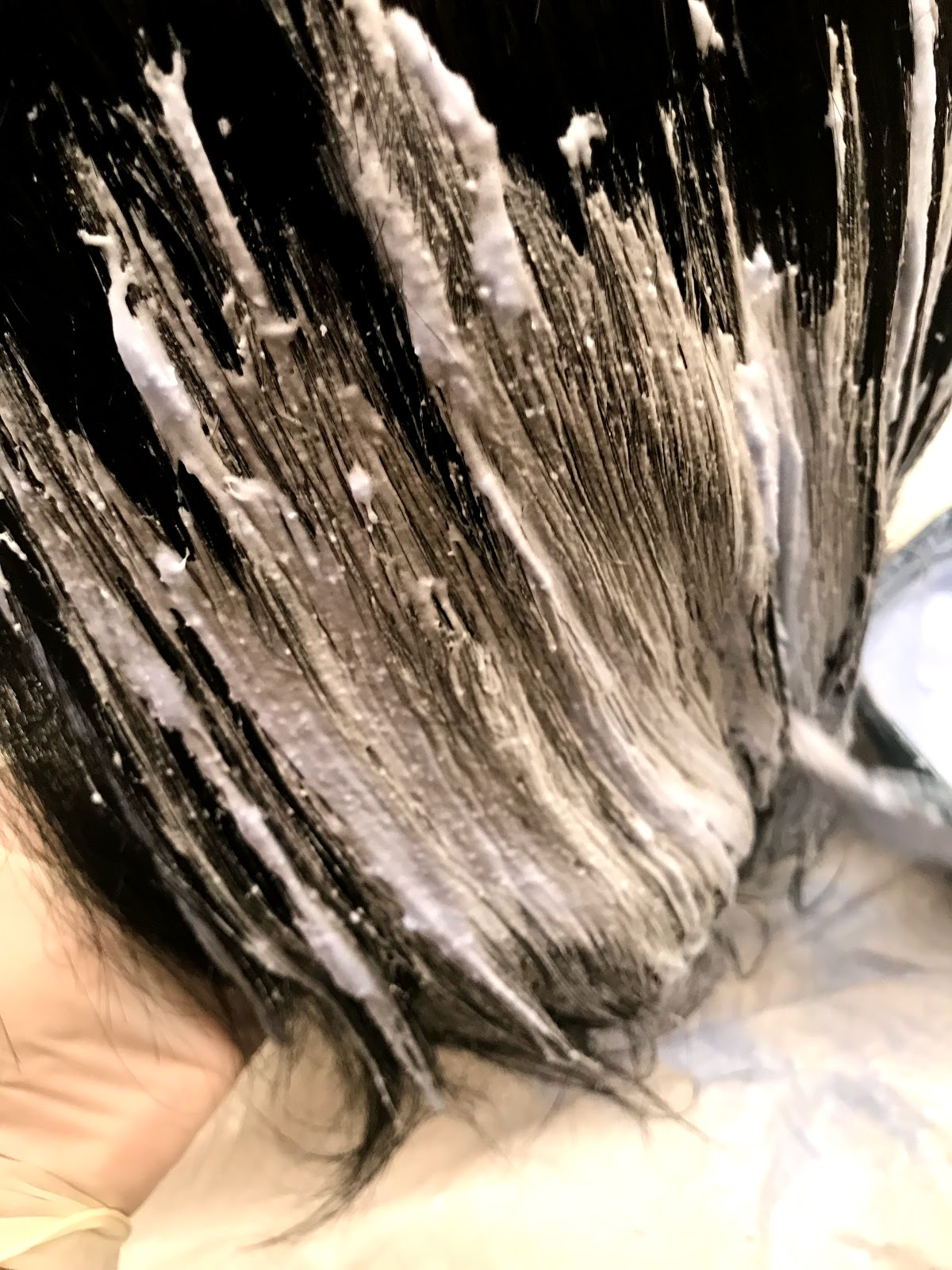 Image: Woman coloring hair: with joico blonde: I started at the bottom of my hair and proceeded upwards. Sidenote: As a stylist, I would not do this technique on a real human. I am coloring a wig, so I winged it which is wrong if I was doing for someone else.