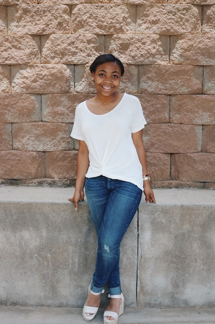 Miss Lauren Alston wearing a white tee shirt and skinny jeans