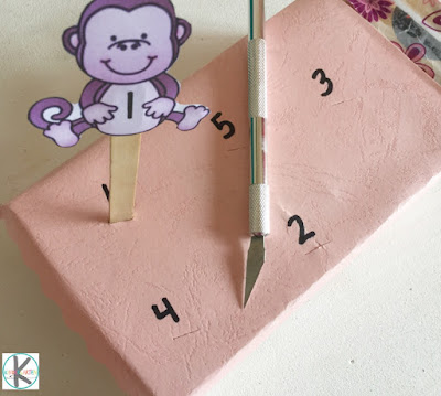cover a small box to make the 5 little monkeys bed