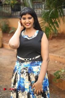 Actress Model Poorni Stills in Floral Long Dress at Silk India Expo Launch  0006.JPG