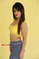 Cute Telugu Actress Shunaya Solanki High Definition Spicy Pos in Yellow Top and Skirt  0099.JPG