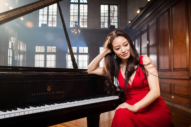 Pianist Kimberly Kong Poses with piano