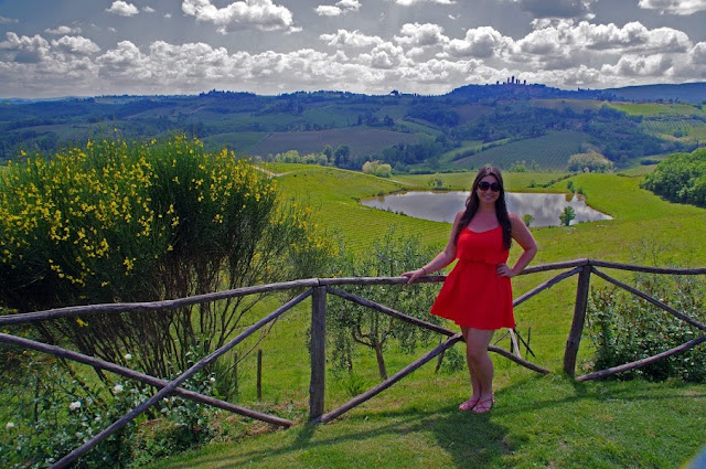 Girl in Tuscany with San Gimignano in Background