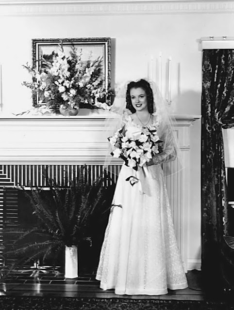 The sixteen-year old bride (Marilyn's birthday was just two weeks days previous) was overcome with emotion at the ceremony and cried.