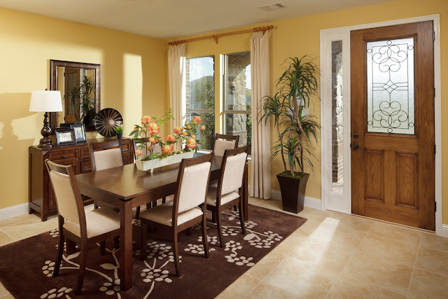 yellow wall living room with dining room in it with wooden door and