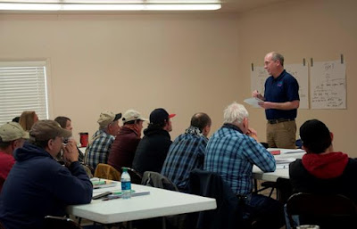 Idaho Falls District Fire Management Officer Joel Gosswiller addresses the group of 40 local ranchers and landowners who will form the District's first RFPA. (Photo by Jesse Bender/BLM)