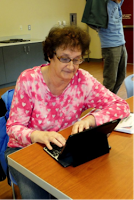 Ms Ronnie using a keyboard and iPad