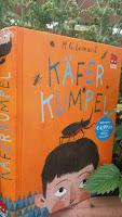das Cover zeigt den Kopf eines Kindes, auf dem ein riesiger Käfer sitzt