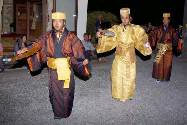 men dressed as royalty dance