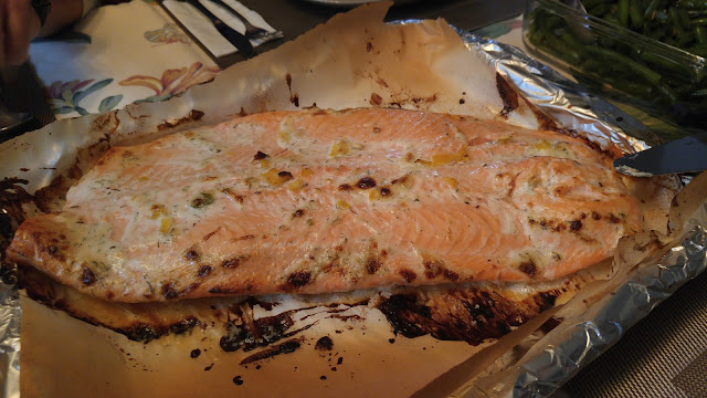 A baking tray of caramelized salmon fresh from the oven.