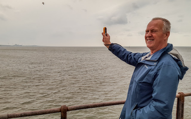 Photo of Phil checking the anemometer at the end of the pier
