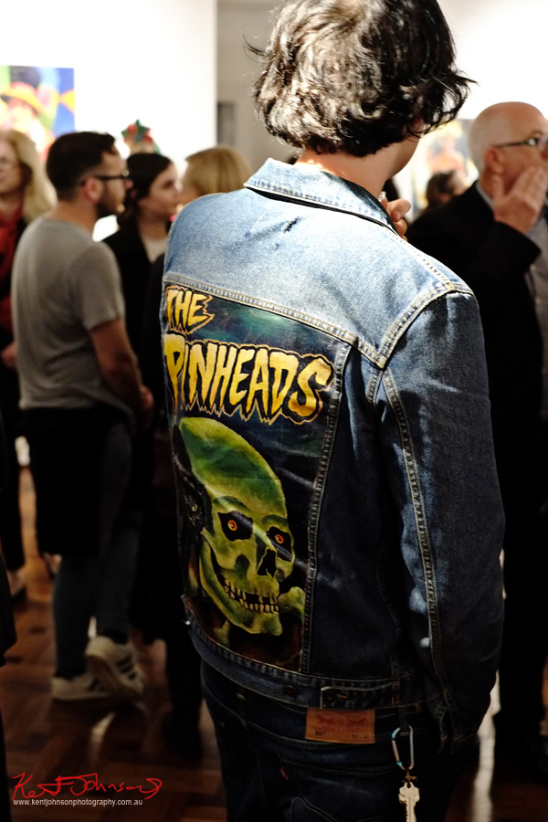Man wearing denim Levis and jacket with The Pinheads, skull motif on back. More Pirates? Street Fashion Sydney by Kent Johnson.