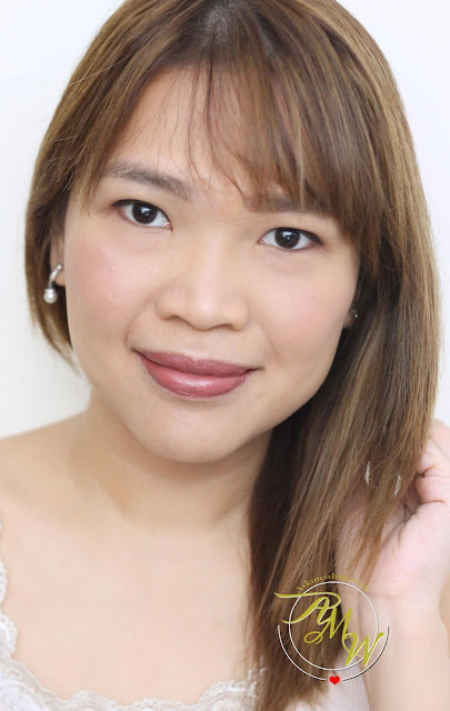 a photo of askmewhats wearing H&M Beauty Cream Lip Colour and Raspberry Lip Balm!