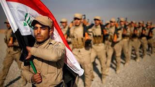 10 Milisi Syiah Dukungan Iran Mengancam PM Iraq, Heider Abadi
