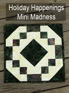 Holiday Happening Mini Madness quilt made with batiks