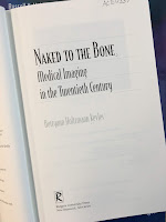 Naked to the Bone: Medical Imaging in the Twentieth Century, by Bettyann Kevles, superimposed on Intermediate Physics for Medicine and Biology.