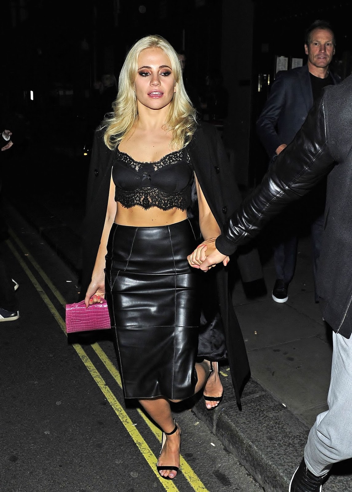 ee7da3b013 British singer & pop star Pixie Lott wearing a black leather pencil skirt  (while stumbling out of a nightclub and looking quite wasted!)