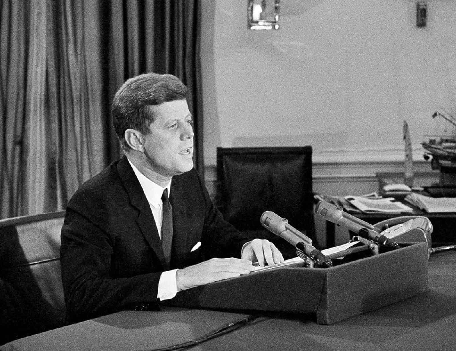 President John F. Kennedy tells the American people that the U.S. is setting up a naval blockade against Cuba, during a television and radio address, on October 22, 1962, from the White House. The president also said the U.S. would wreak