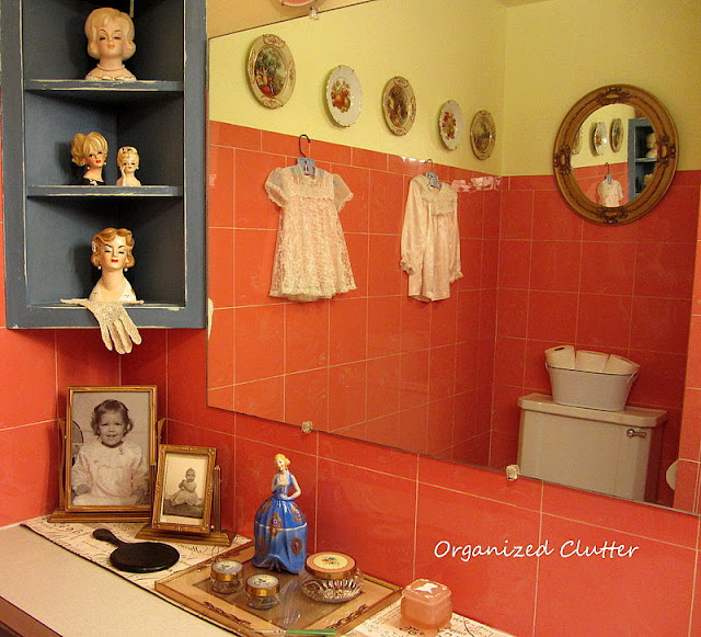 Headvases, vanity jars in a vintage bathroom