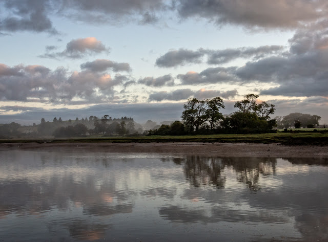 Photo of early morning reflections in the River Dee at Kirkcudbright