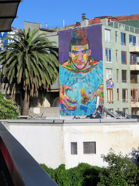 Valparaíso Street Art: Pre-colombian person holding a ship in a bottle