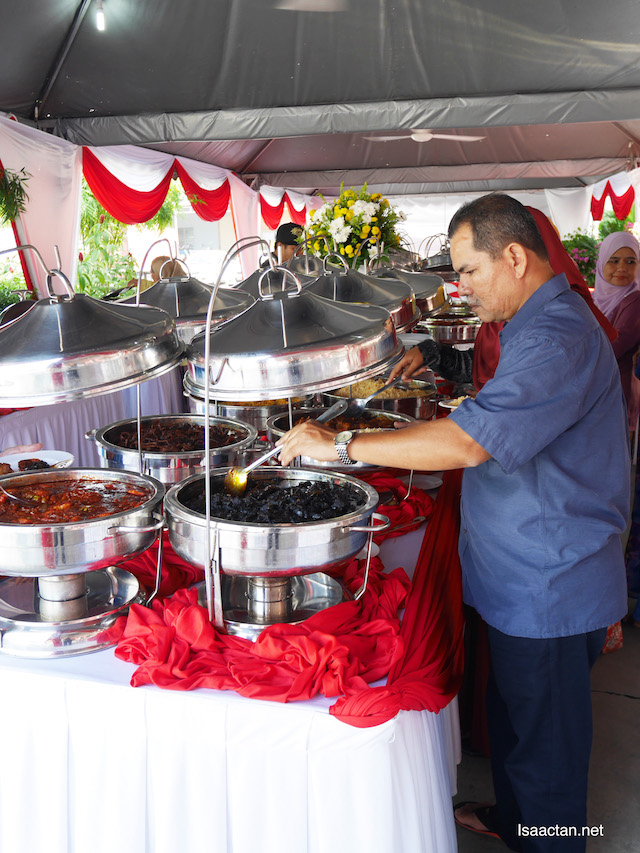 Invited guests savouring Nurul Izzah Catering's fares