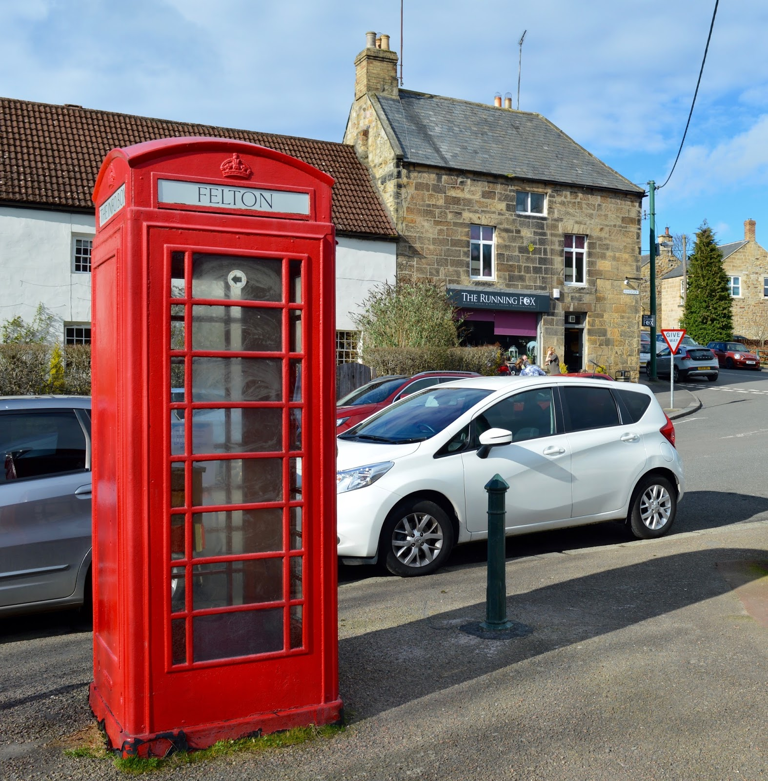 The Northumberland Arms, Felton | Red phone box and the running fox bakery exterior
