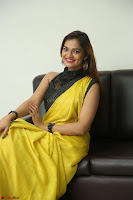 Cute Actress Ashwini in Yellow Saree Exclusive  044.JPG