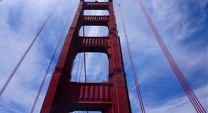 Looking up at the triumphant Golden Gate Bridge