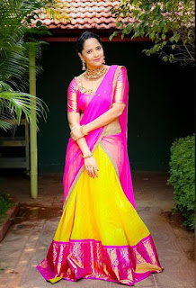 Anasuya looks beautiful in Pink Yellow Saree Choli