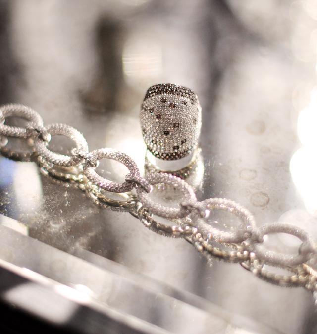 giant pave diamond ring with chocolate sapphires and diamond bracelet