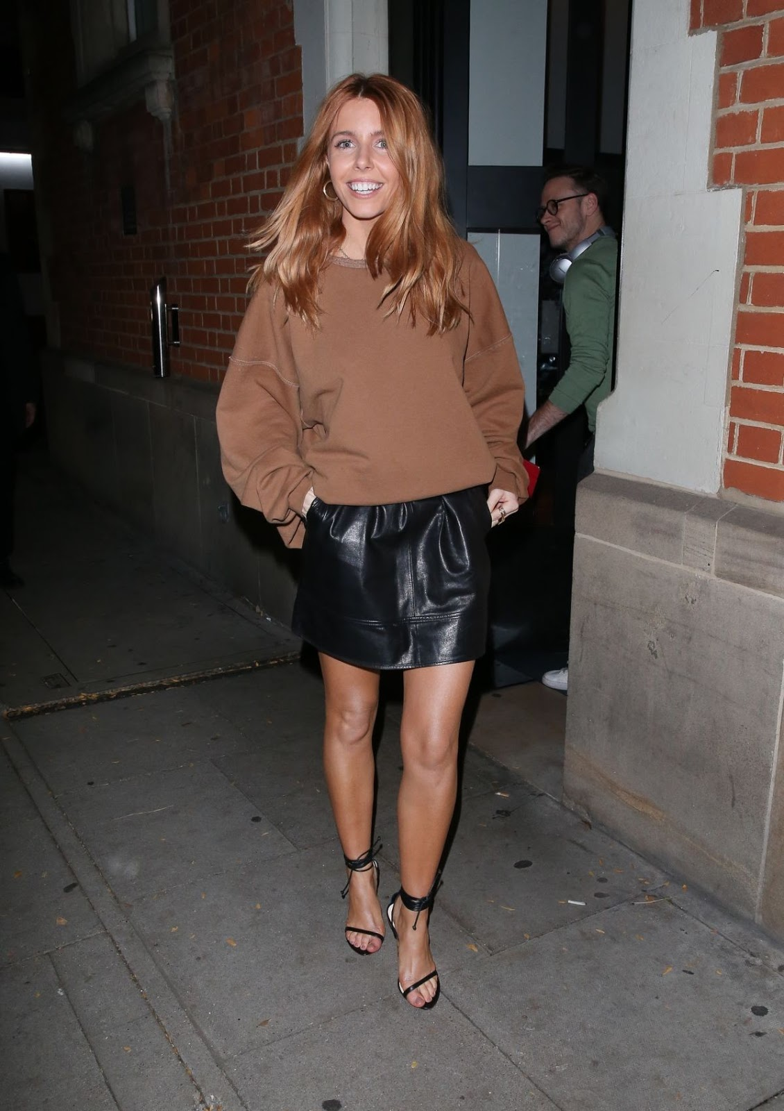 Stacey Dooley In Leather Mini-skirt In London