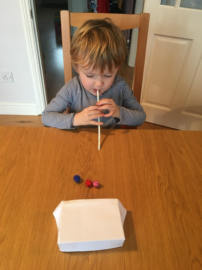 10-five-minute-games-for-toddlers-image-of-toddler-playing-blow-football