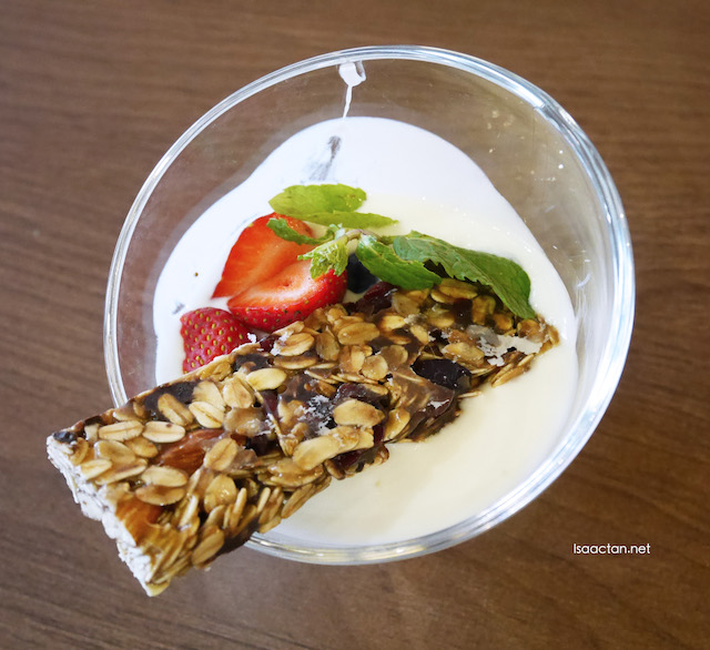 Granola Bar served with berries yogurt