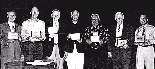 MUFON Board of Directors at the 2009 Symposium -Tom Deuley, Jan Harzan, Dr. Bob Wood, Cliff Clift, John F. Schuessler, and Rob Swiatek, Not pictured - Chuck Reever. (From MUFON UFO Journal, Aug. 2009.)
