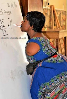 Beautiful Armless Ghanaian Mathematics Teacher Uses Her Mouth to Write On The White Board