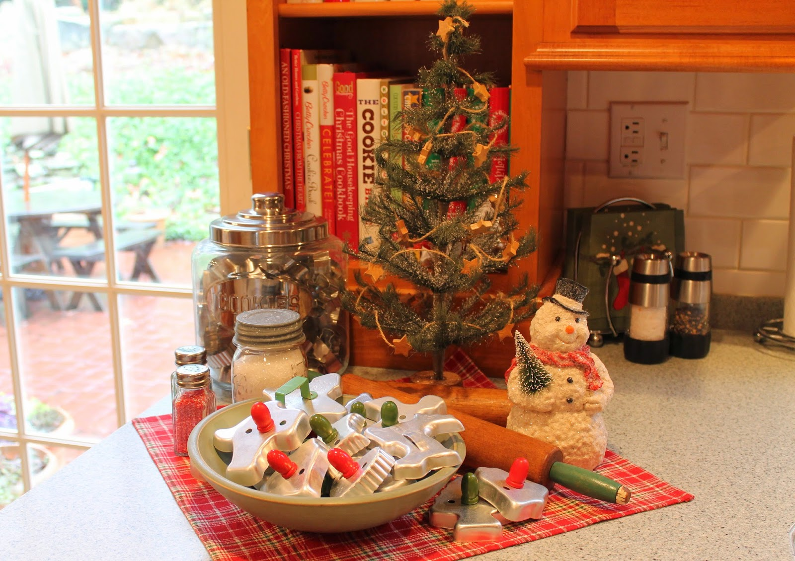 today im sharing a simple little vignette that sits on my kitchen counter and its all about family traditions and baking christmas cookies