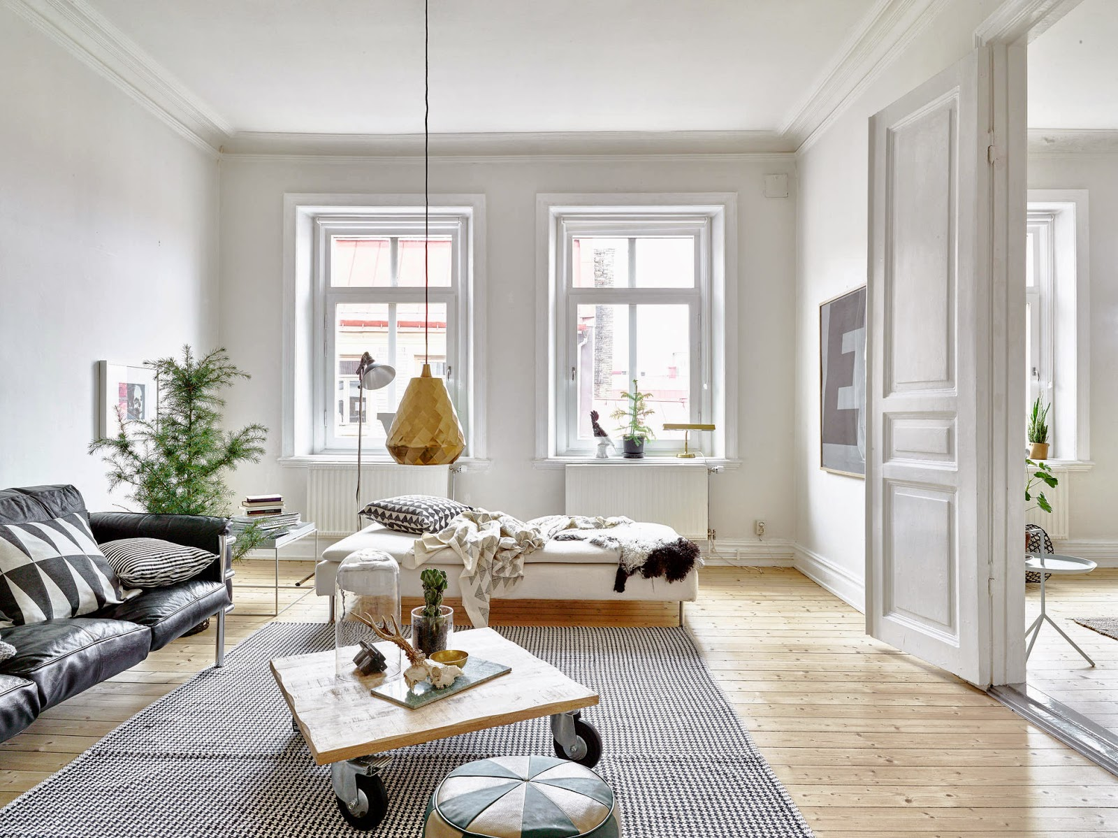 A beautiful white apartment with notes of grey, green and brass ...