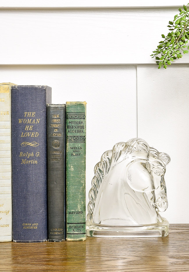 Vintage glass bookends styled on entry table