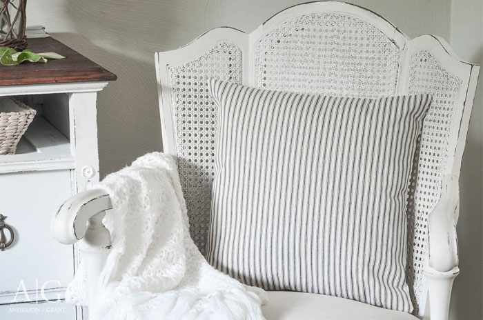 A pair of vintage cane backed chairs found at a garage sale are given a stunning farmhouse style makeover with Fusion Mineral Paint and a simple drop cloth.  |  www.andersonandgrant.com