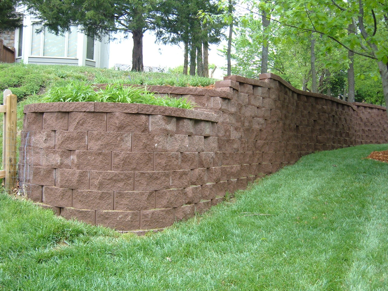 Lawrence Landscape: Replacing a crumbling retaining wall...